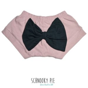 Dusty pink shorts with a black bow on the bum!