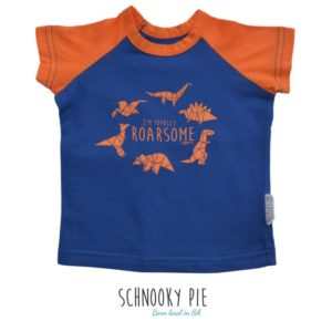 "Orange and Royal Blue raglan t-shirt for boys with orange printed dinosaurs and wording ""Totally Roarsome"" in front"