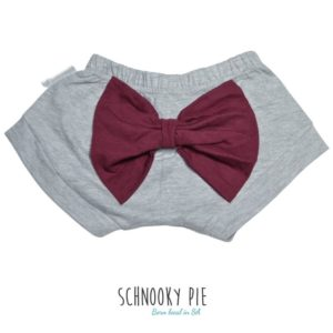 Grey Mélange shorts with a maroon bow on the bum